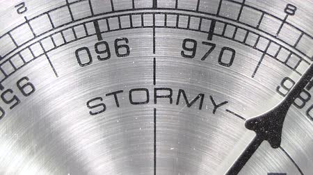 barometr : Barometer pointing towards stormy weather macro detail with zoom.