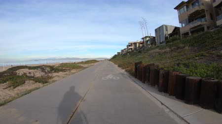 pacífico : Following shadow on bike path in Manhattan Beach near Los Angeles in Southern California.