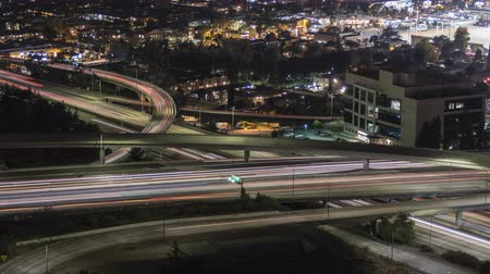sas : Night traffic time lapse view of the Ventura 134 and Glendale 2 freeway interchange in Los Angeles, California.