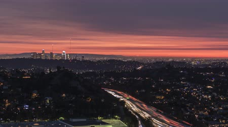 sas : Night traffic time lapse view of the Glendale 2 freeway with downtown Los Angeles in background.