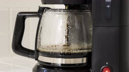 eatery : Coffee maker pot filling close up time lapse.