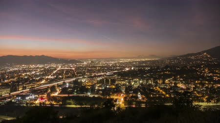 sas : Day to night sunset time lapse view of Glendale and Los Angeles in Southern California. Stock mozgókép
