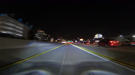 rampa : Los Angeles, California, USA - February 11, 2018:  Night driving time lapse from Century Bl ramp into the 405 freeway car pool lane.