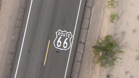 rota : Aerial lift off from historic Route 66 pavement sign in the scenic California Mojave desert.