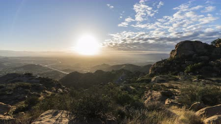 Sunrise time lapse view towards Porter Ranch in the San Fernando Valley area of Los Angeles California.  View from Rocky Peak Park in the Santa Susana Mountains.