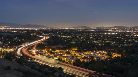 Dusk to night time lapse view of route 118 freeway near Topanga Canyon Bl in the San Fernando Valley area of Los Angeles, California.