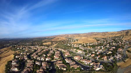 Panning aerial view of suburban Simi Valley in Southern California.