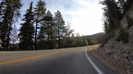 Sunrise car mount drive on Angeles Crest Highway in the San Gabriel Mountains above Los Angeles California. Stok Video