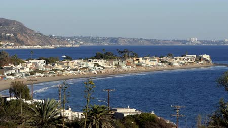 Malibu Colony beach and homes with Santa Monica Bay and Los Angeles in background.