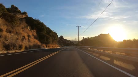 Driving towards sunrise behind Stoney Point in the San Fernando Valley area of Los Angeles, California.