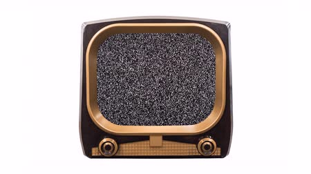 Vintage 1950s television on white with dissolve to static and chroma green screens. Stok Video