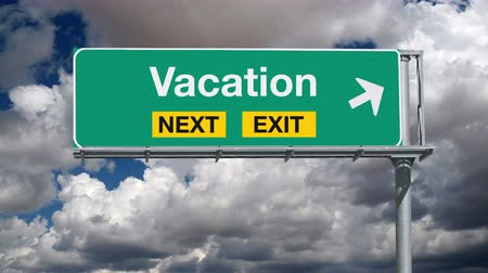time laps : Vacation next exit highway sign with time lapse clouds. Stock Footage