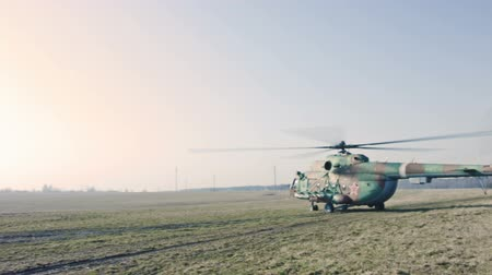 mi : Russian Military Helicopter in the field. Stock Footage