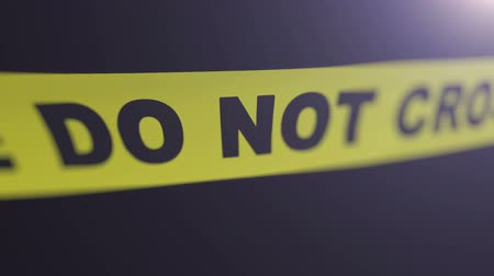 black yellow : Crime scene tape. Matte channel included. Shallow Depth of field.
