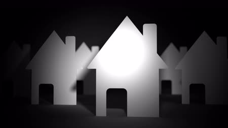 real : Close up of paper houses on black background Stock Footage