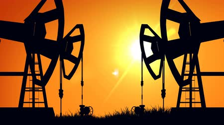 oliwa : Silhouette pump jacks at sunset. Oil industry. Wideo