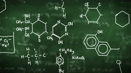 бумага : Chemical formulas on green background. Science concept.