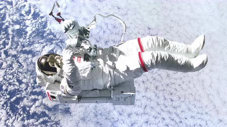 mekik : Animation of Astronaut in outer space against the cloudy blue sky background. Stok Video