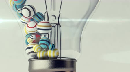 criatividade : A funny 3d rendering of a colorful striped ball. They move up and down between an igniting spiral and lamp rods. It looks hilarious and entertaining.