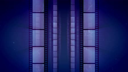 resimlerinde : A vintage 3d rendering of vertical film tapes changing each other as if they are shot in a dolly in way. They are placed in the blue background. They create the mood of creativity and art. Loopable. Stok Video