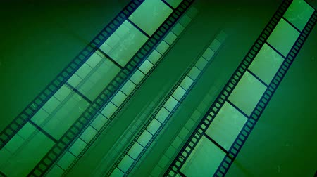 An arty 3d rendering of salad straight film tapes put askew moving forward in the dark green background. They generate the feeling of high art, optimism and cheerfulness. Loopable.