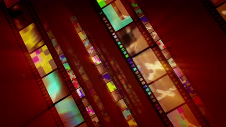 A stunning 3d rendering of diagonal film tapes beaming like mirrors with colorful reflections changing each other as if they are shot in a zoom in way. They advance in the bright brown backdrop. Loopable.