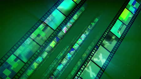 A splendid 3d rendering of diagonally placed straight film tapes sparkling like mirrors with colorful shades. They move forward in the bright green backdrop in an optimistic way. Loopable.
