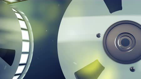 dois objetos : 3d rendering of two retro reels placed in profile with high quality filmstrip rolling slowly. They are rotating in the grey background with yellow blurred spots and create the mood of nostalgia Stock Footage