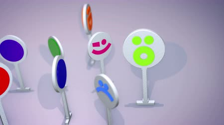 An entertaining 3d rendering of smiling multicolored emoticons looking like big round signs on thin stands and and turning happily in the grey background. Their faces inspire happy mood.