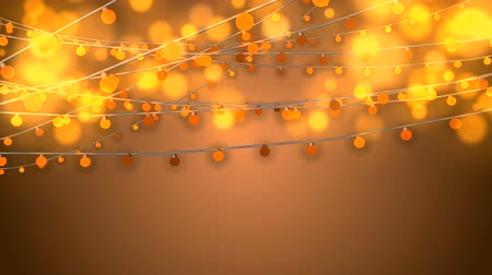 dazzle : A merry 3d rendering of Christmas string lights from yellow bulbs and blured golden balls in the light brown background. They shimmer happily creating the mood of fest and optimism.
