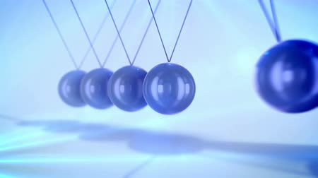 moudrý : A magic 3d rendering of steel balls pendulum with waving diagonally beads hitting each other in a light blue background with blurred dots. They look wise and confident in seamless loops. Dostupné videozáznamy
