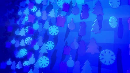 jovial : A jovial 3d rendering of Christmas holiday silouettes forming fest and showing snowmen, fir trees, gift boxes spinning around in the blue background in seamless loop. Vídeos