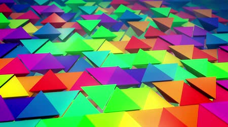 lengthy : Cheerful 3d rendering of colorful pyramids located horizontally in straight and long lines with some pyramids pushed out with bottoms up. It looks original, childish and impressive. Stock Footage