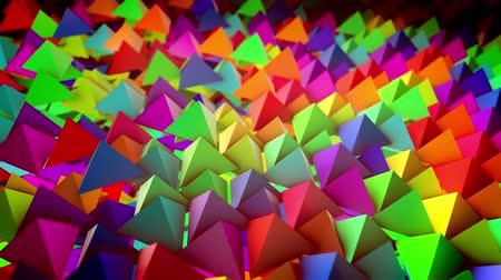 aimed : Cheery 3d rendering of multicolored pyramids located on a flat surface horizontally in straight and long rows with their sharp tops aimed up. It looks wonderful, childish and innovative.