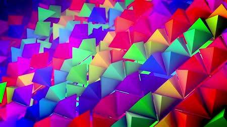 lengthy : Optimistic 3d rendering of rainbow pyramids located on a slanted surface in straight and long rows with their sharp tops aimed up. It looks optimistic, innovative, and funny.