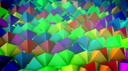 lengthy : Jolly 3d rendering of rainbow pyramids placed on a slanted surface in straight and long rows with their sharp tops aimed up. It looks like an optimistic dolly out shot.