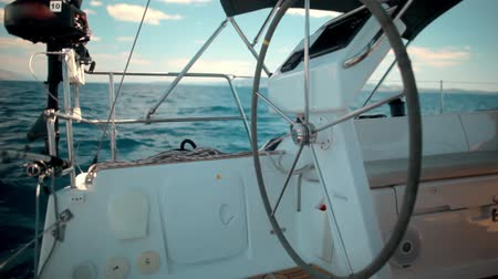 mariner : Sail Yacht steering wheel sailing boat Stock Footage