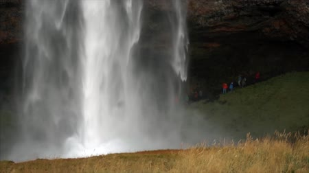 skogafoss : Giant waterfall with little people on background