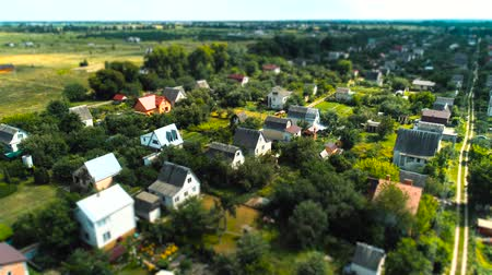 tilt shift : Village fly over houses aerial survey tilt shift miniature Stock Footage