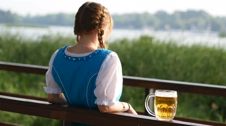 pretzel : The blond girl stands near the bridge with beer Stock Footage