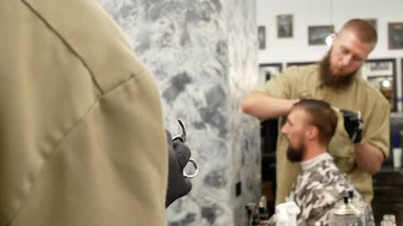 barber hair cut : Reflection of the hairdresser and the client in the mirror Stock Footage