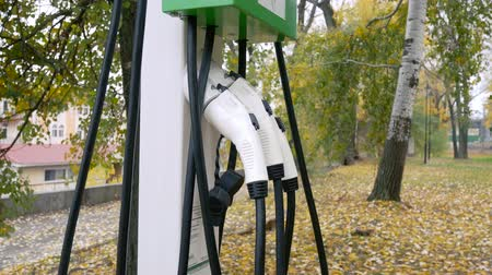 auto parking : Charge station in the backwoods. Concept of eco friendly transport Stock Footage