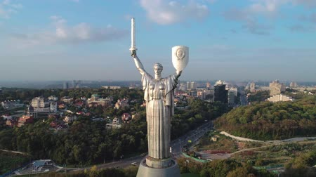 kard : Time lapse. Soviet-era monumental statue Motherland Mother with a shield and sword in the capital of Ukraine, Kiev. Early sunset. Overall plan