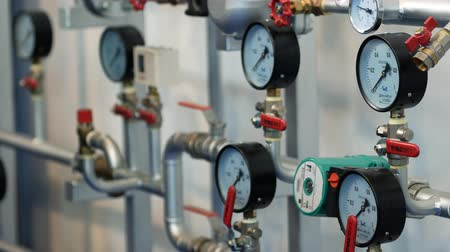 pompki : Pipes and valves with gauge pressure controllers on the wall at the exhibition. Close up
