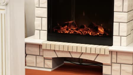sahte : Artificial fireplace with white brick. Exhibition sample. Warm house. Homely atmosphere