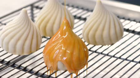 námraza : Glazing mousse cakes with orange mirror glaze. Domed shape