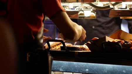 barbecued : Waiter picks up the ordered pork ribs. Fried vegetables and meat on the restaurant counter Stock Footage