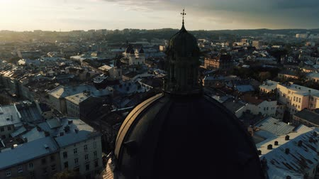 lviv : Fly over medieval catholic church in old city at sunset. Lviv city. Cultural center of Ukraine