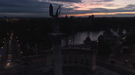 heroes square : Aerial fly over Archangel Gabriel monument in Budapest. Square of Heroes. Early sunset
