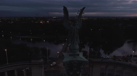 heroes square : Aerial fly over Square of Heroes at sunrise in Budapest. Archangel Gabriel monument. Early sunset